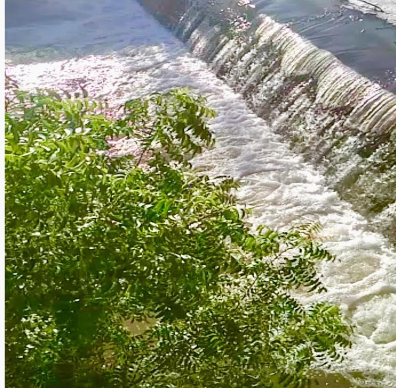 water flowing over bund
